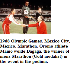1968 Olympic Games. Mexico City, Mexico. Marathon. Oromo athlete Mamo wolde Dagaga, the winner of  mens Marathon (Gold medalist) in the event in the podium.