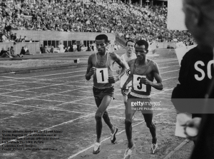 Oromo (Oromian) athletes Abebe Bikila (L) and Mamo Wolde Dagaga (R) in exhibition race at Berlin Olympic Stadium. (Photo by Robert Lackenbach.The LIFE Picture Collection.Getty Images)