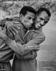 Oromo (Oromian) runners Abebe Bikila (L) & Mamo Wolde (R) during exhibition race at Berlin Olympic Stadium. (Photo by Robert Lackenbach.The LIFE Picture Collection.Getty Images)