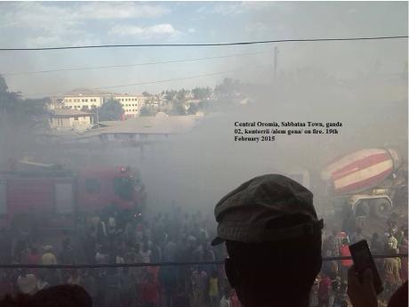 Central Oromia, Sabbataa Town, ganda 02, kenterrii (alem gena) on fire. 19th February 2015