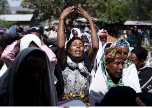 Women mourn during the funeral ceremony of a primary school teacher who family members said was shot dead by military forces during protests in Oromia