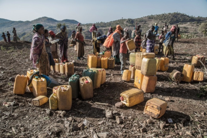 Ethiopians wait to fill water cans in February during the recent drought. With the return of the rains, however, have come flooding and disease — something the government is reluctant to discuss. (Aida Muluneh for The Washington Post)