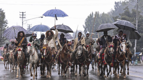 Oromo men, wearing their traditional costume.png
