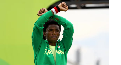 Oromo Olympic marathon athlete Fayyisaa Lalisaa on the Guardian. #OrompProtests global icon p1