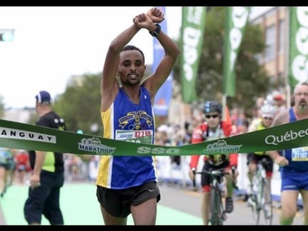 Quebec City Marathon winner, Oromo athlete, Ebisa Ejigu, replicates Rio Olympic medallist's #OromoProtests