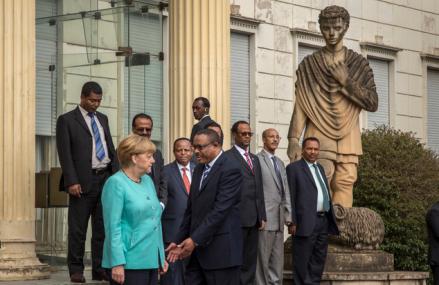 angela-merkel-refused-a-handshake-when-faced-hailemariam-dessalegn-no-photo-opportunity-for-the-fascist-in-finfinne-oromia-ethiopia-october-11-2016-africa-visit