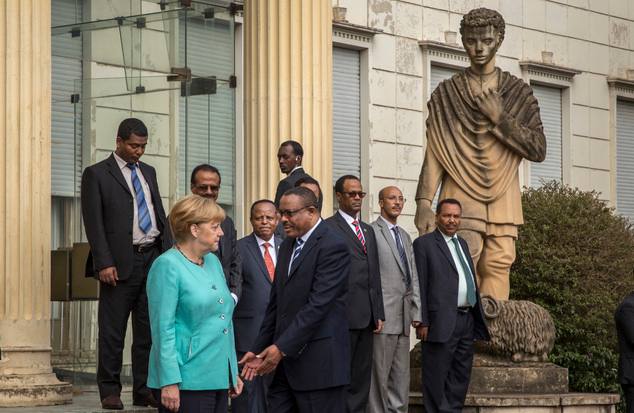 angela-merkel-refused-a-handshake-when-faced-hailemariam-dessalegn-no-photo-opportunity-for-the-fascist-in-finfinne-oromia-ethiopia-october-11-2016-africa-visit