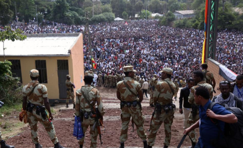 fascist-tplf-armed-security-forces-watch-as-protesters-stage-a-protest-against-government-during-the-irreechaa-cultural-festival-in-bishoftu-oromia-ethiopia-on-october-02-2016