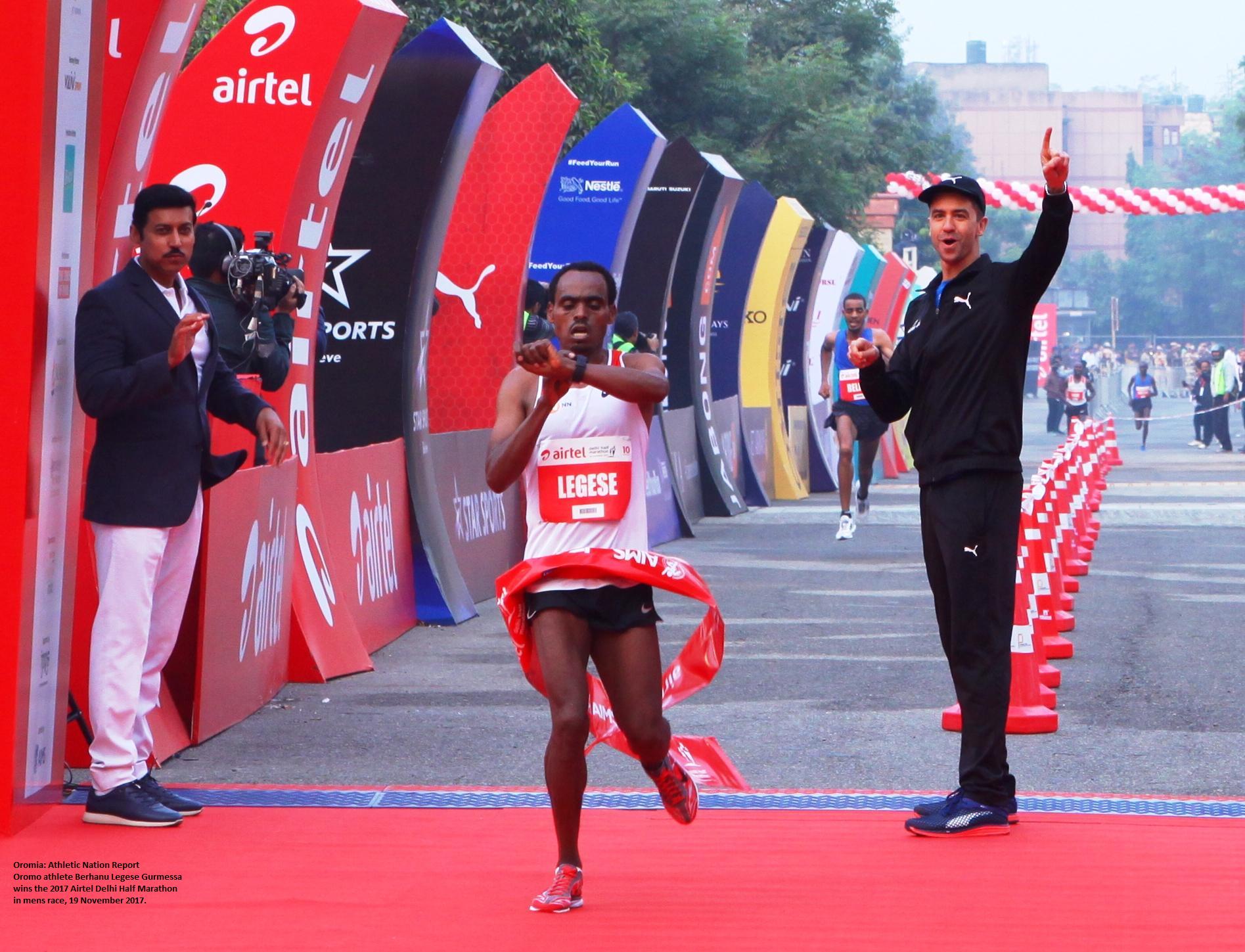 Oromo athlete  Berhanu Legese Gurmessa wins win 2017 Airtel Delhi Half Marathon on 19th November 2017.png